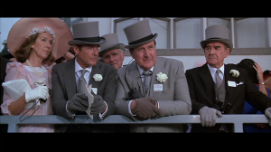 Bond and his MI6 buddies at the horse races, wearing fancy hats and being very WASP-y